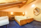 Hotel Bellamonte in Predazzo, Beispiel Familienzimmer