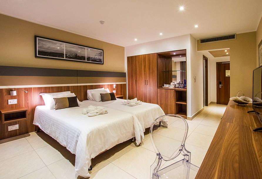 In Ihrem Hotelzimmer können Sie sich optimal nach einem ereignisreichen Tag erholen.